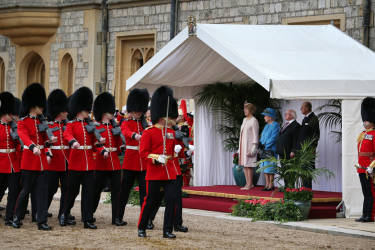 Britain's Queen Elizabeth II (3rd R), stands with her husband Prince Philip (R), President of Ireland Michael D Higgins (2nd R) and his wife Sabina during a ceremonial welcome at Windsor Castle, West of London, on April 8, 2014. Higgins arrived in London on Monday ahead of the first state visit by a president of the republic since it gained independence from neighbouring Britain. The visit comes three years after Queen Elizabeth II made a groundbreaking trip to the republic, which helped to heal deep-rooted unease and put British-Irish relations on a new footing. AFP PHOTO/POOL/PETER MACDIARMID