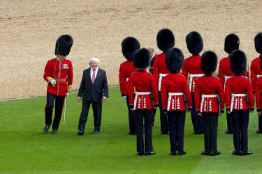 The President of Ireland Michael D. Higgins inspects the guard of honour at Windsor Castle in Windsor, southern England April 8, 2014. The Irish President and his wife Sabina are embarking on a four day State Visit to Britain, and will stay at Windsor Castle as guests of Queen Elizabeth. REUTERS/Steve Parsons/pool  (BRITAIN - Tags: POLITICS ROYALS SOCIETY ENTERTAINMENT)