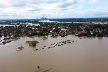 This image made available by the Serbian police shows the flooded area in Obrenovac, some 30 kilometers (18 miles) southwest of Belgrade, Serbia, Sunday, May 18, 2014. In Serbia, more than 20,000 people have been forced from their homes. Officials there fear more flooding later Sunday as floodwaters travel down the Sava and reach the country. Serbian officials said that the flood wave might be lower than initially expected, because the river broke barriers upstream in Croatia and Bosnia. Experts said they expect Sava floodwaters to rise for two more days, then subside. (AP Photo/Serbian Police)