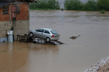 A car remains parked on a ramp to protect it from flooding in a suburb of Sarajevo on Wednesday, May 14, 2014. Heavy rainfall caused the river Bosna to flood surrounding areas causing power cuts and road blockades in some suburban and rural areas. (AP Photo/Amel Emric)