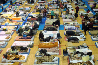 People lay in on matresses in a collective centre for people evacuated from the flooded town of Obrenovac on May 19, 2014 in Obrenovac, some 30km southwest of Belgrade. The worst floods in more than a century that hit Serbia and Bosnia claimed 45 victims so far and tens of thousands who were evacuated were still homeless on May 19. In Serbia and Bosnia some 50,000 people had to be evacuated from the areas affected by floods.  Obrenovac was one of the most severely hit towns and a plant near there, which is producing 50 percent of the electricity in the Balkan country, was surrounded by water.   AFP PHOTO / ALEXA STANKOVIC