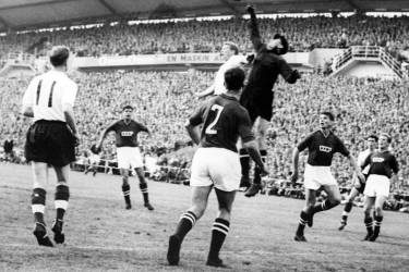 Goalkeeper Lev Yashin (black) from the Soviet Union boxes the ball away from an English player during the World Cup first round soccer match between the Soviet Union and England 08 June 1958 in Goteborg. The match ended in a 2-2 tie. AFP PHOTO/PRESSENBILD