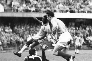 Brazilian Pele (C) scores a goal as French goalkeeper Claude Abbes (on the ground) tries to stop the ball, on June 24, 1958 during the semifinal World Cup, at the Rasunda Stadium of Solna, in Stockholm.