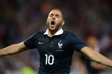 France's forward Karim Benzema celebrates after scoring a goal during the friendly football match between France and Jamaica at the Pierre Mauroy stadium, on June 08, 2014, ahead of the 2014 FIFA World Cup football tournament. AFP PHOTO / DENIS CHARLET