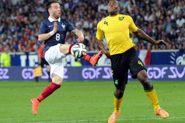 France's midfielder Mathieu Valbuena (L) vies with Jamaican's defender Lloyd Doyley during a friendly football match between France and Jamaica, on June 08, 2014 at the Pierre Mauroy stadium in Villeneuve d'Ascq, northern France, ahead of the 2014 FIFA World Cup football tournament. AFP PHOTO / PHILIPPE HUGUEN