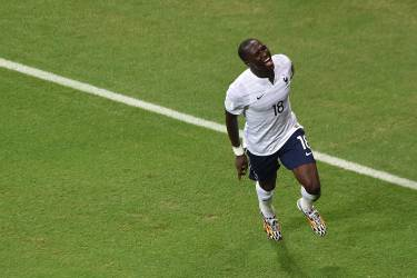 TOPSHOTS France's midfielder Moussa Sissoko celebrates after scoring during a Group E football match between Switzerland and France at the Fonte Nova Arena in Salvador during the 2014 FIFA World Cup on June 20, 2014.  AFP PHOTO / DIMITAR DILKOFF