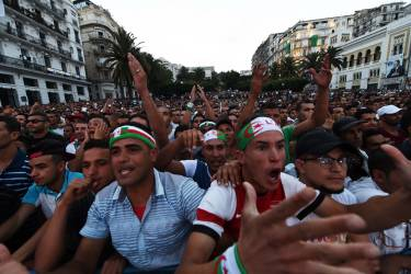 Algeria's fans react as they watch the FIFA 2014 World Cup football match Algeria vs South Korea on a big screen in central Algiers, on June 22, 2014. AFP PHOTO/FAROUK BATICHE