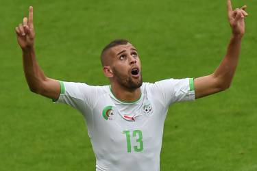 Algeria's forward Islam Slimani celebrates after scoring a goal during the Group H football match between South Korea and Algeria at the Beira-Rio Stadium in Porto Alegre during the 2014 FIFA World Cup on June 22, 2014. AFP PHOTO / PEDRO UGARTE