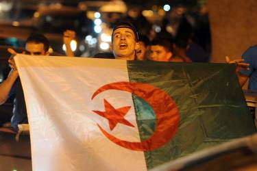 Algerian fans celebrate in Algiers on June 22, 2014 after Algeria defeated South Korea 4-2 in a FIFA 2014 World Cup Group H match.   AFP PHOTO/FAROUK BATICHE