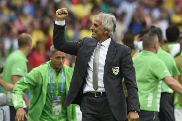Algeria's Bosnian coach Vahid Halilhodzic celebrates after his team scored a goal during the Group H football match between South Korea and Algeria at the Beira-Rio Stadium in Porto Alegre during the 2014 FIFA World Cup on June 22, 2014.  AFP PHOTO / PHILIPPE DESMAZES