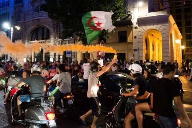 Algeria's football fans celebrate on the Canebiere in Marseille, southern France, on June 22, 2014 after Algeria defeated South Korea 4-2 in a FIFA 2014 World Cup Group H match. AFP PHOTO / BERTRAND LANGLOIS