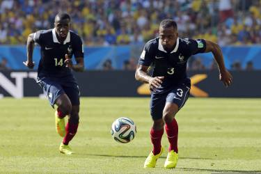 France's Patrice Evra, right, and Blaise Matuidi chase the ball during the World Cup quarterfinal soccer match between Germany and France at the Maracana Stadium in Rio de Janeiro, Brazil, Friday, July 4, 2014. (AP Photo/David Vincent)