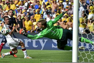Germany's goalkeeper Manuel Neuer makes a save during the World Cup quarterfinal soccer match between Germany and France at the Maracana Stadium in Rio de Janeiro, Brazil, Friday, July 4, 2014. (AP Photo/Martin Meissner)