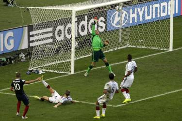 Germany's goalkeeper Manuel Neuer, top, makes a save after a shot by France's Karim Benzema, left, in the very last minute of the World Cup quarterfinal soccer match between Germany and France at the Maracana Stadium in Rio de Janeiro, Brazil, Friday, July 4, 2014. Germany beat France 1-0 and advanced to the semifinal.  (AP Photo/Thanassis Stavrakis)