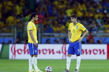 Brazil's Fred (L) and Oscar prepare to kick off at the start of the second half against Germany during their 2014 World Cup semi-finals at the Mineirao stadium in Belo Horizonte July 8, 2014. REUTERS/Eddie Keogh (BRAZIL  - Tags: SOCCER SPORT WORLD CUP)