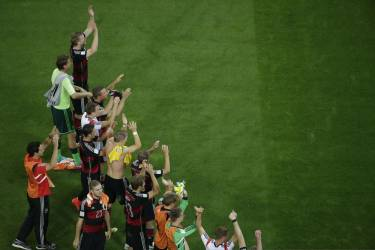 Germany's players celebrate after the semi-final football match between Brazil and Germany at The Mineirao Stadium in Belo Horizonte during the 2014 FIFA World Cup on July 8, 2014. AFP PHOTO / POOL /  FELIPE DANA