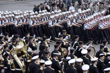 French firefighters parade on July 14, 2014 on the Champs Elysees avenue in Paris during the annual Bastille Day military parade. AFP PHOTO / STEPHANE DE SAKUTIN