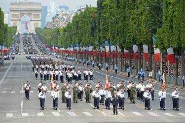 Students from the Air Forec special school march down the Champs-Elysees avenue during the annual Bastille Day military parade in Paris, on July 14, 2014.   AFP PHOTO / ALAIN JOCARD