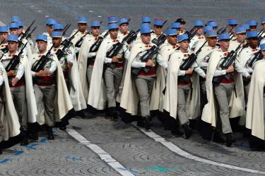 Soldiers of the 1st Regiment of Spahis march down the Champs-Elysees avenue during the annual Bastille Day military in Paris, on July 14, 2014.  AFP PHOTO / ALAIN JOCARD