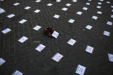Banners with the names of every Palestinian person recently killed by  Israeli airstrikes  on the Gaza strip are laid out on the ground, following a protest,  in Barcelona, Spain, Thursday, July 17, 2014. About 2,000 people took part in the demonstration.  (AP Photo/Emilio Morenatti)