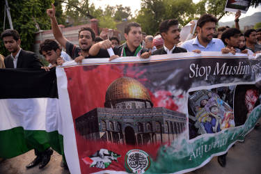 Palestinian and Pakistani nationals shout anti-Israel slogans during a demonstration against Israeli military operations in Gaza in Pakistan's Islamabad on July 17, 2014. Israeli tank fire killed three people in the Gaza Strip medics said, as the overall death toll from 10 days of violence in the Palestinian territory rose to 231. AFP PHOTO/Aamir QURESHI