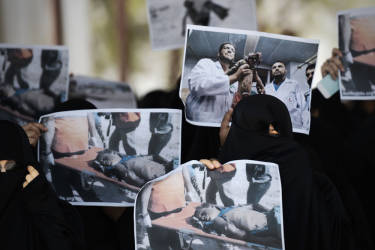Bahraini women hold pictures of victims during a protest against Israel's military operation in the Gaza Strip on July 18, 2014, in the village of Diraz, west of Manama. Israel launched a major offensive in Gaza on July 8 aimed at halting cross-border rocket fire by Palestinian militants and began a ground operation preceded by an intense bombardment on July 18.   AFP PHOTO/MOHAMMED AL-SHAIKH