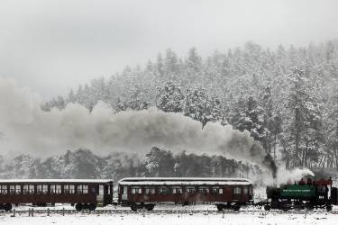 A vintage 1880 Train chugs through the snow-covered hills between Hill City and Keystone, S.D., Thursday morning, Sept. 11, 2014. Riders on the popular summertime tourist attraction got a very wintertime view as a storm brought as much as 8 inches of snow to parts of the Black Hills. Snowfall in downtown Rapid City marked the earliest such event since 1888; that was before South Dakota was even a state. (AP Photo/Rapid City Journal, Chris Huber) TV OUT