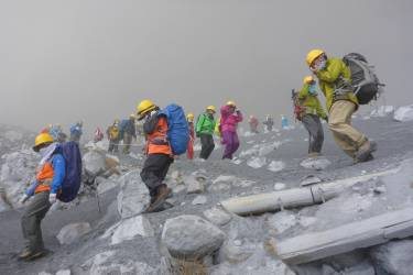 Climbers descend Mt. Ontake, which straddles Nagano and Gifu prefectures, to evacuate as volcanic ash falls at the mountain in central Japan September 27, 2014, in this photo taken by a climber and released by Kyodo. The Mt. Ontake volcano erupted on Saturday, killing one woman and seriously injuring more than 30 people, officials and media said. The Japan Meteorological Agency said the volcano, 200 km (125 miles) west of Tokyo, erupted just before midday and sent ash pouring down the mountain's south slope for more than three km (two miles).  Mandatory credit.   REUTERS/Kyodo (JAPAN - Tags: DISASTER ENVIRONMENT TPX IMAGES OF THE DAY)  ATTENTION EDITORS - THIS IMAGE HAS BEEN SUPPLIED BY A THIRD PARTY. IT IS DISTRIBUTED, EXACTLY AS RECEIVED BY REUTERS, AS A SERVICE TO CLIENTS. MANDATORY CREDIT. JAPAN OUT. NO COMMERCIAL OR EDITORIAL SALES IN JAPAN. YES