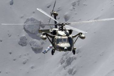 An injured person is lifted by a rescue helicopter of Japan Self-Defense Force (JSDF) at Mt. Ontake, which straddles Nagano and Gifu prefectures in this September 28, 2014 photo taken and released by Kyodo. More than 500 Japanese military and police set out on Sunday to search the peak of a volcano popular with hikers a day after its sudden eruption trapped hundreds on the mountain for hours, amid conflicting reports about missing and injured climbers.   Mandatory credit.   REUTERS/Kyodo (JAPAN - Tags: DISASTER ENVIRONMENT SOCIETY)   ATTENTION EDITORS - THIS IMAGE HAS BEEN SUPPLIED BY A THIRD PARTY. THIS PICTURE WAS PROCESSED BY REUTERS TO ENHANCE QUALITY. AN UNPROCESSED VERSION WILL BE PROVIDED SEPARATELY. MANDATORY CREDIT. JAPAN OUT. NO COMMERCIAL OR EDITORIAL SALES IN JAPAN. YES