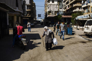 An elderly woman walks through Bab el-Tabaneh district in Tripoli. Lebanese Troops take over rebel bastion after three days of fierce fighting with al-Qaeda inspired Sunni rebels. Tuesday, October 28, 2014. Diego Ibarra Sánchez for LE MONDE