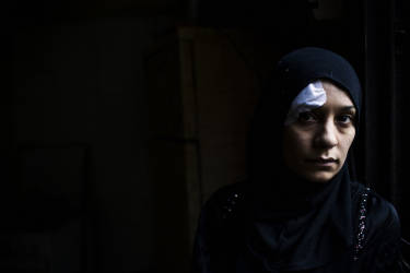 Asma Al Zoabi posses for a portrait at her home. She was injured and her cousin was dead during the clashes. Lebanese citizens had to leave their homes at 5 am in the morning. Tuesday, October 28, 2014. Diego Ibarra Sánchez for LE MONDE