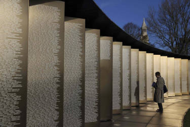 """A man visits the new war memorial at Notre Dame de Lorette, an elliptical ring engraved with the names of the 580,000 men who died in northern France during the First World War, in Ablain-Saint-Nazaire November 5, 2014. The memorial, paying respect to fighters of all nationalities who perished in this land between 1914 and 1918, is on the edge of the Notre-Dame de Lorette French war cemetery, itself containing the bodies of over 40,000 soldiers. Designed by the architect Philippe Prost, the """"Ring of Memory"""" will be inaugurated on Armistice Day on November 11 by French President, in the presence of dignitaries from other countries involved in the conflict. The year 2014 marks the centennial commemoration for the soldiers who fought in the First World War (WWI).  REUTERS/Pascal Rossignol (FRANCE - Tags: MILITARY ANNIVERSARY CONFLICT)"""