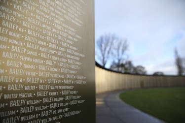 """A view shows the new war memorial at Notre Dame de Lorette, an elliptical ring engraved with the names of the 580,000 men who died in northern France during the First World War, in Ablain-Saint-Nazaire November 5, 2014. The memorial, paying respect to fighters of all nationalities who perished in this land between 1914 and 1918, is on the edge of the Notre-Dame de Lorette French war cemetery, itself containing the bodies of over 40,000 soldiers. Designed by the architect Philippe Prost, the """"Ring of Memory"""" will be inaugurated on Armistice Day on November 11 by French President, in the presence of dignitaries from other countries involved in the conflict. The year 2014 marks the centennial commemoration for the soldiers who fought in the First World War (WWI).  REUTERS/Pascal Rossignol (FRANCE - Tags: MILITARY ANNIVERSARY CONFLICT)"""
