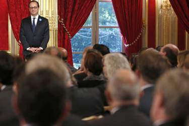 French president Francois Hollande attends a ceremony for the winners of the 'Young Artists of Memory' contest, an initiative to educate children about the First World War through the medium of art, at the Elysee Palace in Paris, France, Tuesday Nov. 11, 2014. Tuesday marks Armistice Day and is commemorated every year on Nov. 11 to mark the armistice signed between the allies of World War I and Germany to end the war. (AP Photo/Ian Langsdon/Pool)