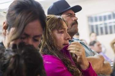 Delia Patino (C), Ana Maria Patino (L), and Rafael Patino (R), become emotional while watching U.S. President Barack Obama's national address in Phoenix, Arizona November 20, 2014. Obama imposed the most sweeping immigration reform in a generation on Thursday, easing the threat of deportation for about 4.7 million undocumented immigrants and setting up a clash with Republicans.  REUTERS/Deanna Dent  (UNITED STATES - Tags: POLITICS SOCIETY IMMIGRATION)