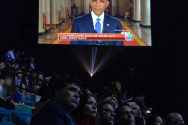 The audience at the 15th Annual Latin Grammy Awards sh in Las show in Las Vegas, Nevada, watches as US President Barack Obama delivers a speech on immigration on November 20, 2014. AFP PHOTO/MARK RALSTON