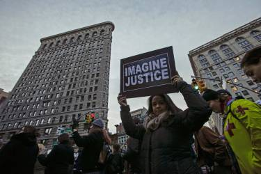 People march against police violence in Midtown Manhattan, New York December 13, 2014. Thousands marched in Washington, New York and Boston on Saturday to protest killings of unarmed black men by police officers.   REUTERS/Eduardo Munoz (UNITED STATES - Tags: CIVIL UNREST CRIME LAW POLITICS)