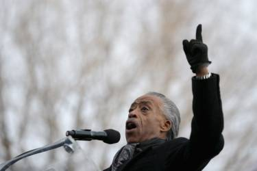 """WASHINGTON, DC - DECEMBER 13: Rev. Al Sharpton address the """"Justice For All"""" march and rally in the nation's capital December 13, 2014 in Washington, DC. Organized by Sharpton's National Action Network, this march and others like it across the country aim to tell Congress and the country that demonstrators will not stand down until there is systemic change, accountability and justice in cases of police misconduct. Sharpton said the demonstration is happening in Washington """"because all over the country we all need to come together and demand this Congress deal with the issues, that we need laws to protect the citizens in these states from these state grand jurors.""""   Chip Somodevilla/Getty Images/AFP == FOR NEWSPAPERS, INTERNET, TELCOS & TELEVISION USE ONLY =="""