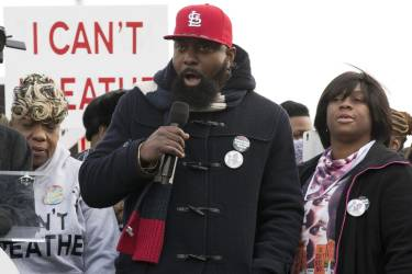 Michael Brown, Sr., the father of Michael Brown, speaks during the National Action Network National March Against Police Violence in Washington December 13, 2014. Thousands of marchers gathered in Washington and New York on Saturday to protest killings of unarmed black men by law enforcement officers and to urge Congress to do more to protect blacks from unjustified police violence.    REUTERS/Joshua Roberts    (UNITED STATES - Tags: POLITICS CRIME LAW CIVIL UNREST)