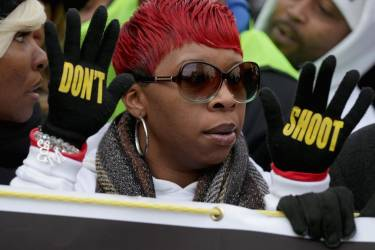 """WASHINGTON, DC - DECEMBER 13: Lesley McSpadden, mother of police shooting victim Michael Brown helps lead the """"Justice For All"""" rally and march in the nation's capital against police brutality and the killing of unarmed black men by police, December 13, 2014 in Washington, DC. Organized by Rev. Al Sharpton's National Action Network, this march and other like it across the country aim to tell Congress and the country that demonstrators will not stand down until there is systemic change, accountability and justice in cases of police misconduct. Sharpton said the demonstration is happening in Washington """"because all over the country we all need to come together and demand this Congress deal with the issues, that we need laws to protect the citizens in these states from these state grand jurors.""""   Chip Somodevilla/Getty Images/AFP == FOR NEWSPAPERS, INTERNET, TELCOS & TELEVISION USE ONLY =="""