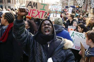 People shout slogans against police as they take part in a march against police violence, in New York December 13, 2014. Thousands of demonstrators gathered in Washington on Saturday for a march to protest the killings of unarmed black men by law enforcement officers and to urge Congress to do more to protect African-Americans from unjustified police violence. Organizers said the event and the parallel march in New York City would rank among the largest in the recent wave of protests against the killings of black males by officers in Ferguson, Missouri, New York, Cleveland and elsewhere.  REUTERS/Eduardo Munoz (UNITED STATES - Tags: CIVIL UNREST CRIME LAW POLITICS)