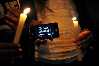 People take part in a demo to show solidarity for the victims of the attack on the offices of France's satirical weekly Charlie Hebdo, in Bogota, Colombia on January 7, 2015. Cities and towns worldwide staged vigils late Wednesday in solidarity with the French people after the massacre by Islamist gunmen in Paris against a satirical paper left at least 12 dead. AFP PHOTO / GUILLERMO LEGARIA